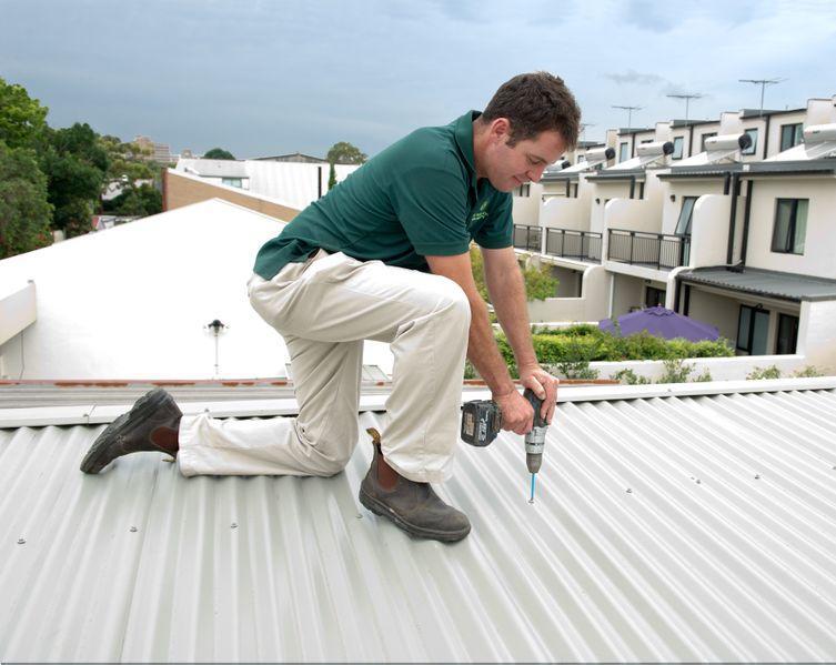 Dan performing a roof install in rockdale