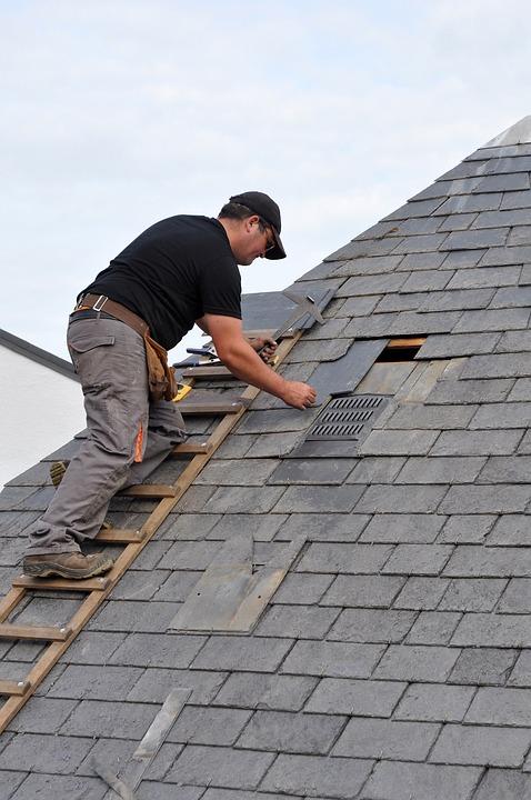 robbie performing some roof restoration